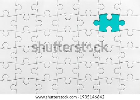 White jigsaw puzzle pattern missing piece White jigsaw puzzle pattern isolated front image top view to express alliance union team working solution success problem Royalty-Free Stock Photo #1935146642