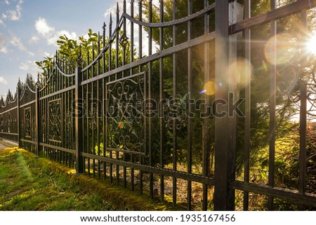 Wrought Iron Fence. Metal fence Royalty-Free Stock Photo #1935167456