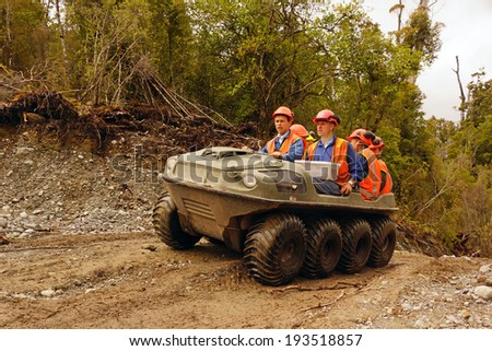 GREYMOUTH, NEW ZEALAND, 23-12-2013: Unidentified men travel in an all terrain vehicle while working in the bush on the West Coast of New Zealand #193518857