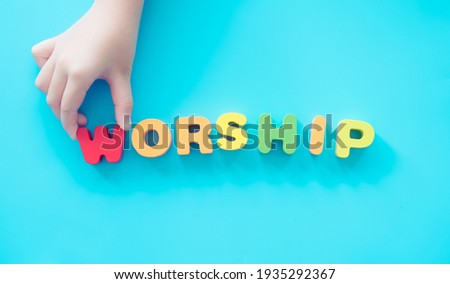 """The word """"Worship"""" and kid hands for sunday school service.kid church good friday and easter day in church christian background.Sunday service.Online worship.Faith Praise to Jesus.pray.bible study."""