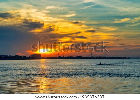 A quiet afternoon on the Mekong River. This stretch of the river flows through the Vinh Long province of Vietnam Royalty-Free Stock Photo #1935376387