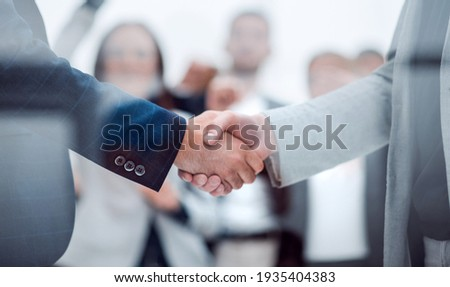 close up. confident business handshake on an office background. Royalty-Free Stock Photo #1935404383