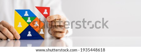 HR Recruitment Hand Making Tangram Puzzle. Talent Management Royalty-Free Stock Photo #1935448618