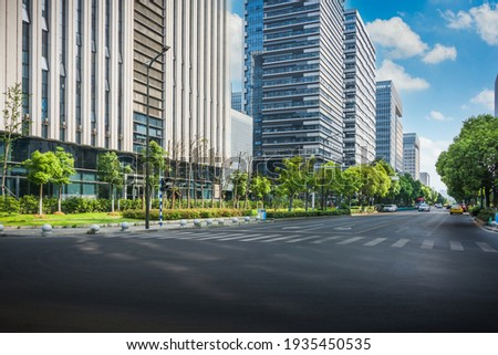 Cityscape office buildings with modern corporate architecture - business and success concept Royalty-Free Stock Photo #1935450535