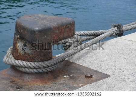 Bollard in a port for mooring ships  Royalty-Free Stock Photo #1935502162