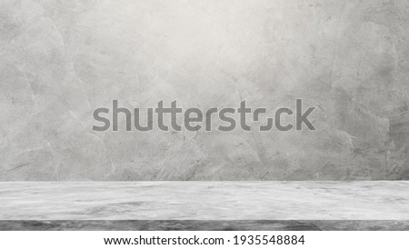 Empty Gray Wall Room interiors Studio Concrete Backdrop and Floor cement Shelf, well editing montage display products and text present on free space Background  Royalty-Free Stock Photo #1935548884