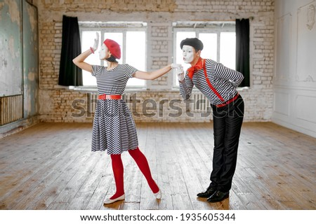 Two mime artists, love couple parody scene