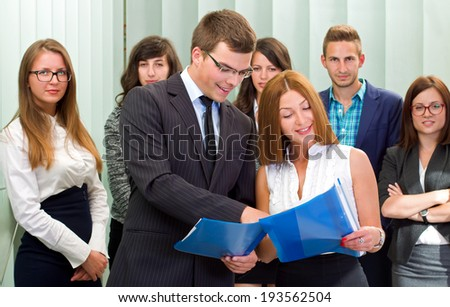 Confident businessman signing the contract in front of his team #193562504
