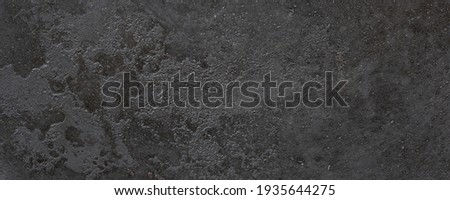 texture of cast iron plate - metal surface background Royalty-Free Stock Photo #1935644275
