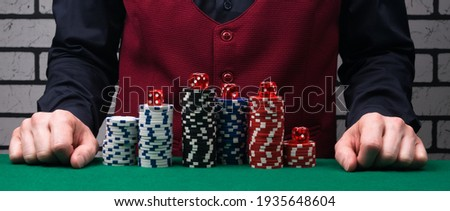 the concept of poker chips in front of the dealer