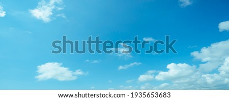 Air clouds in the blue sky.blue backdrop in the air. abstract style for text, design, fashion, agencies, websites, bloggers, publications, online marketers, brand, pattern, model, animation, Royalty-Free Stock Photo #1935653683