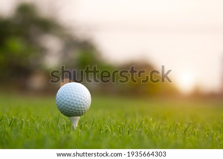 golf ball on tee in a beautiful golf course with morning sunshine.Ready for golf in the first short.Sports that people around the world play during the holidays for health. Royalty-Free Stock Photo #1935664303