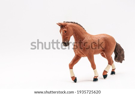 Realistic plastic toy horse, isolate on white background. Cute little horse toy for kids. Copy space