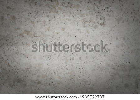 Full frame image of the old rough concrete wall with abstract pattern. High resolution texture with dark vignetted corners for background, poster or collage, copy space