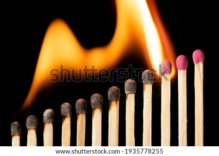 Upcoming line of matches igniting one by one. Concept of development, positive statistics Royalty-Free Stock Photo #1935778255