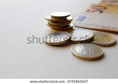 Euro coins and 50 euro banknotes. Project of European currency Royalty-Free Stock Photo #1935863647
