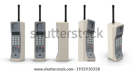 Old cell phone called brick phone made in early 1980s. Vintage mobile telephone. Isolated white background 3d illustration different angle view realistic set
