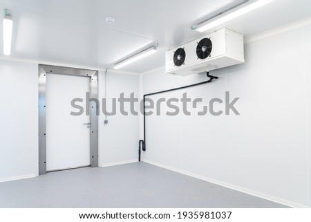 an empty industrial room refrigerator with four fans Royalty-Free Stock Photo #1935981037