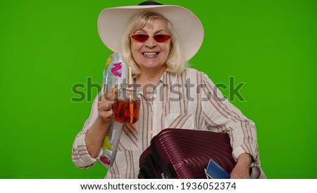 Senior old woman traveler tourist drinking cocktail, dancing, holding tickets, luggage bag waiting for holiday resort vacations. Mature grandmother passenger travel on weekends. Tourism, trip to sea