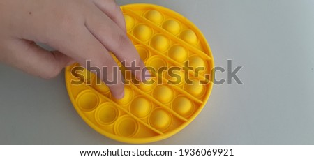The pop it is a stress-reducing toy Royalty-Free Stock Photo #1936069921