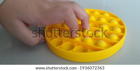 The pop it is a stress-reducing toy Royalty-Free Stock Photo #1936072363