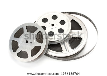 Old film reel with strip isolated on a white background. Royalty-Free Stock Photo #1936136764