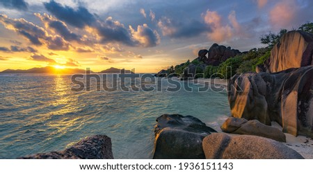 sunset at tropical beach anse source d'argent on la digue,seychelles