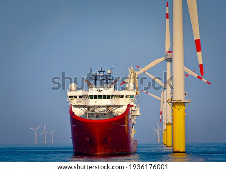 Sevice operations vessel in dynamic positioning sat of offshore wind turbine Royalty-Free Stock Photo #1936176001