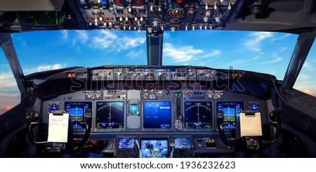 Cockpit pilot Flight Deck display. Throttle jet cabin with control panel plane. View in windows blue sky clouds Royalty-Free Stock Photo #1936232623
