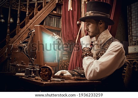Adventure world of steampunk. Scientist steampunk man inventor works at the computer in his laboratory. Victorian interior. Royalty-Free Stock Photo #1936233259