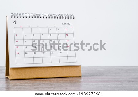 April Calendar 2021 on wooden table background Royalty-Free Stock Photo #1936275661