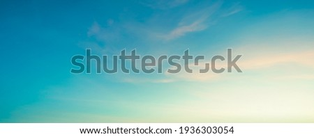 The sky has the light of the sun; the sky is blue; there are small and large clouds alternating and moving slowly; with the sunlight passing; creating a miraculous abstract shape; a hot day. Royalty-Free Stock Photo #1936303054