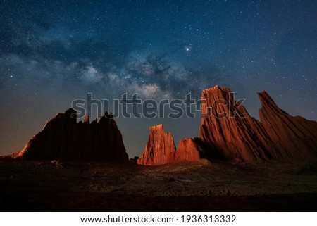 Milky Way Galaxy, Long exposure Photograph with grain. Star Study and Milky Way Astronomy at Lalu. The milky way and cross above canyon, LaLu in province of Sa kaeo, Thailand Royalty-Free Stock Photo #1936313332