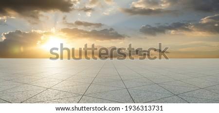 Empty triangle shape stone tiles floor with sky .