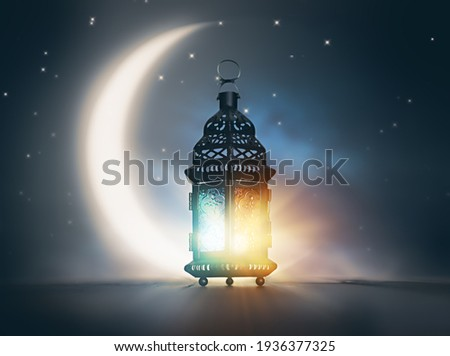 Ornamental Arabic lantern with burning candle glowing at night. Festive greeting card, invitation for Muslim holy month Ramadan Kareem. Royalty-Free Stock Photo #1936377325