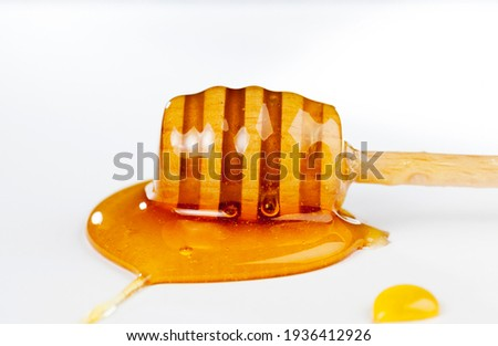 dipped in honey specially made from wood homemade coarse spoon, sweet bee honey and one wooden spoon that allows you to transfer and pour honey without dripping and spreading