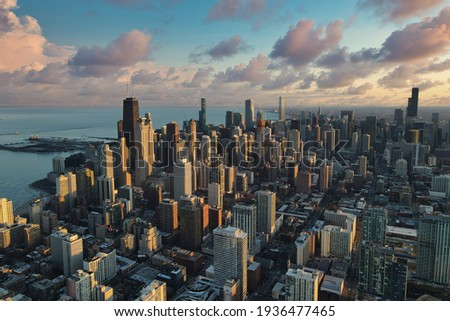 Chicago downtown aerial panorama view at sunset with skyscrapers and city skyline at Michigan lakefront with colorful cloud. Royalty-Free Stock Photo #1936477465