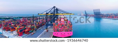 Large international containers cargo ship at industrial import-export port prepare to load containers with big container loader ship vessel. Container ship,global transportation and logistic business. Royalty-Free Stock Photo #1936646740