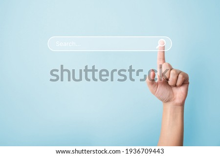 Searching information data on internet networking concept. Hand of man touching magnifying glass icon search
