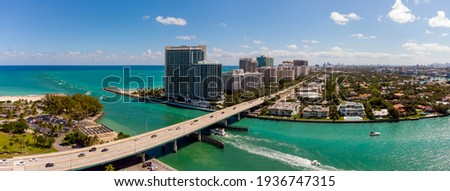 Aerial panorama Miami Beach Haulover Bal Harbour inlet bridge over water Royalty-Free Stock Photo #1936747315