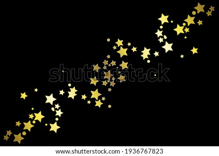 Gold stars on a black background. Festive fireworks