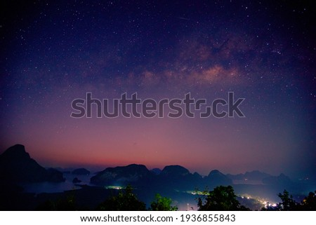 Abstract background of celestial stars, blurred wallpaper of the Milky Way at night, is a natural beauty. Seen during the time of the season Royalty-Free Stock Photo #1936855843