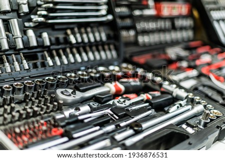 Toolkits put up for sale in a hardware store. Royalty-Free Stock Photo #1936876531