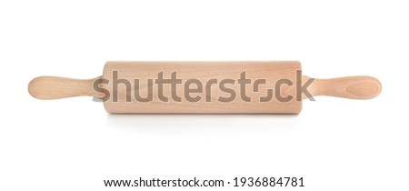 Rolling pin on white background Royalty-Free Stock Photo #1936884781