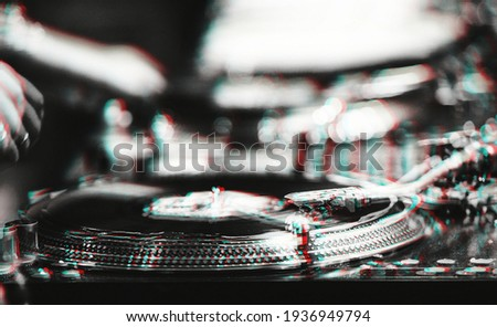 Professional dj turntables on concert stage.Disc jockey turn table player with vinyl records on hip hop party in night club.Download royalty free images collection with djs music for design template