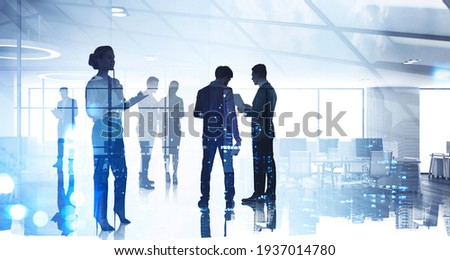 Silhouettes of diverse business people working together, toned image of office interior and skyscrapers. Concept of modern office with managers, partners Royalty-Free Stock Photo #1937014780