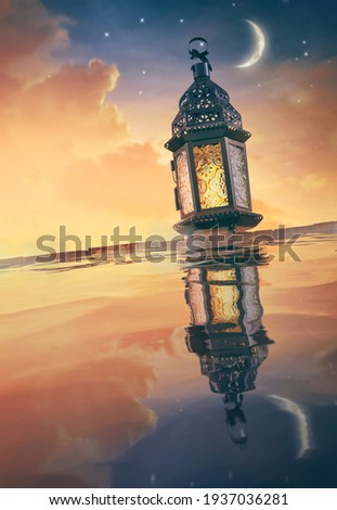 Ornamental Arabic lantern with burning candle glowing at night. Festive greeting card, invitation for Muslim holy month Ramadan Kareem. Royalty-Free Stock Photo #1937036281