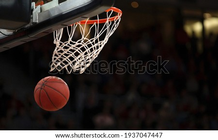 A basketball hoop and a ball Royalty-Free Stock Photo #1937047447