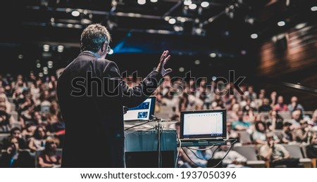 Public speaker giving talk at Business Event. Royalty-Free Stock Photo #1937050396