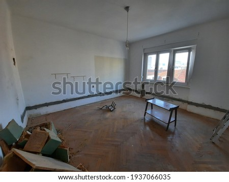 A dirty and dusty derelict apartment Royalty-Free Stock Photo #1937066035